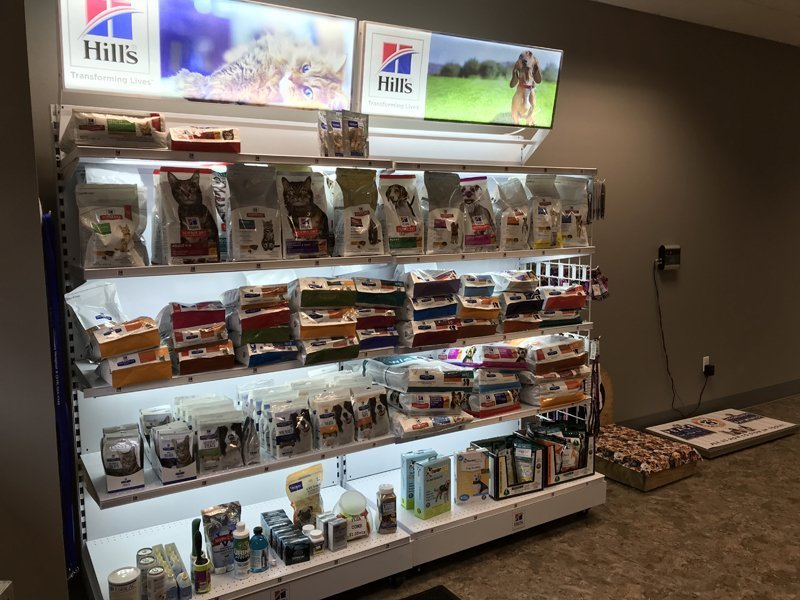 The dog and cat product display in the front of the clinic